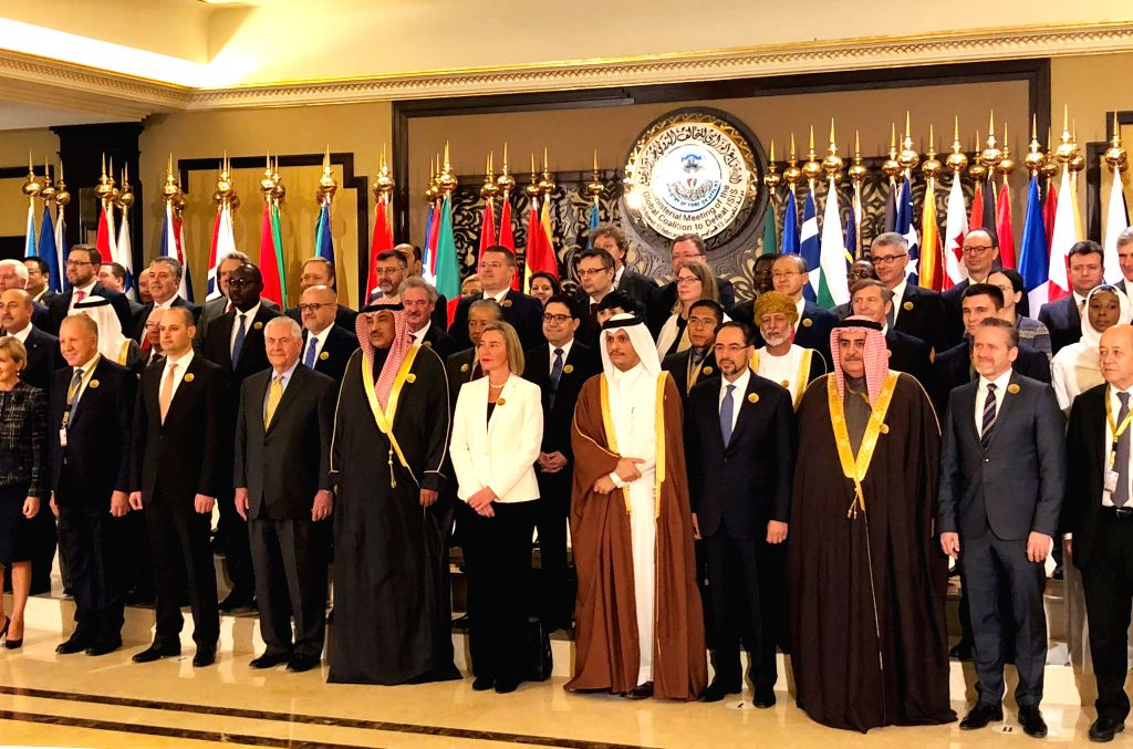 KUWAIT CITY, Feb. 13, 2018 - Delegates pose for a group photo during a ministerial meeting of the International Coalition against the Islamic State (IS), in Kuwait City, Kuwait, on Feb. 13, 2018. The ...