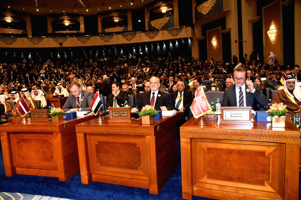 KUWAIT CITY, Feb. 14, 2018 - Photo taken on Feb. 14, 2018 shows attendees at the ministerial meeting of the Kuwait International Conference for the Reconstruction of Iraq (KICRI).