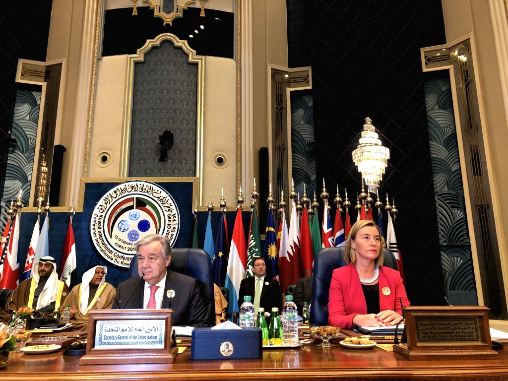 KUWAIT CITY, Feb. 14, 2018 - The EU High Foreign Policy Chief Federica Mogherini (R front) and United Nations Secretary-General Antonio Guterres (L front) attend the ministerial meeting of the Kuwait ...