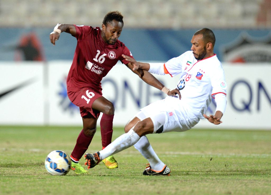 Jarah Al Ateeqi (R) of Kuwait's Al Kuwait SC vies with Sy Cheikh of Lebanon's Nejmeh SC during their AFC CUP 2015 Football match in Kuwait City, Kuwait, on Feb. ...