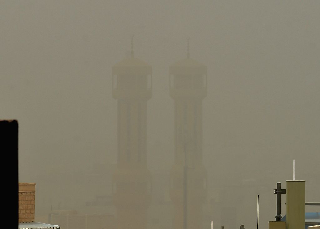 KUWAIT CITY, July 19, 2019 - Photo taken on July 19, 2019 shows buildings shrouded in heavy dust of a sandstorm in Hawalli Governorate, Kuwait.