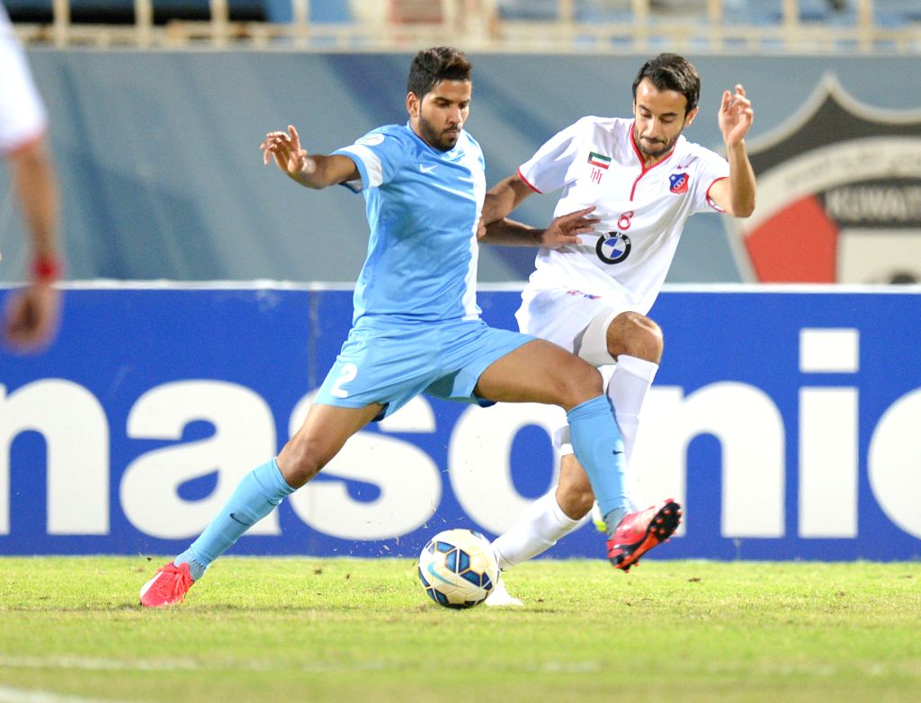 Abdulla Buraiki (R) of Kuwait's Al Kuwait SC vies with Sayed Dhiya of Bahrain's Riffa SC during their AFC CUP 2015 Football match in Kuwait City, Kuwait, on ...
