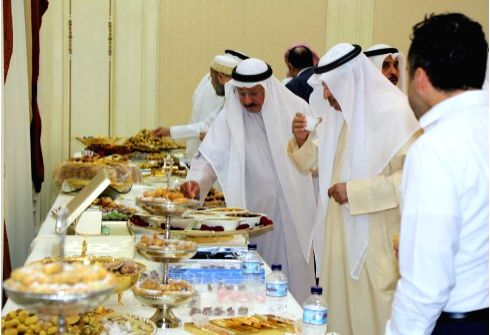 KUWAIT CITY, May 23, 2018 - Kuwaiti people eat sweets at a local family party after sunset in Ramadan, in Kuwait City, Kuwait, May 23, 2018. Kuwaiti people eat sweets during the month of Ramadan to ...