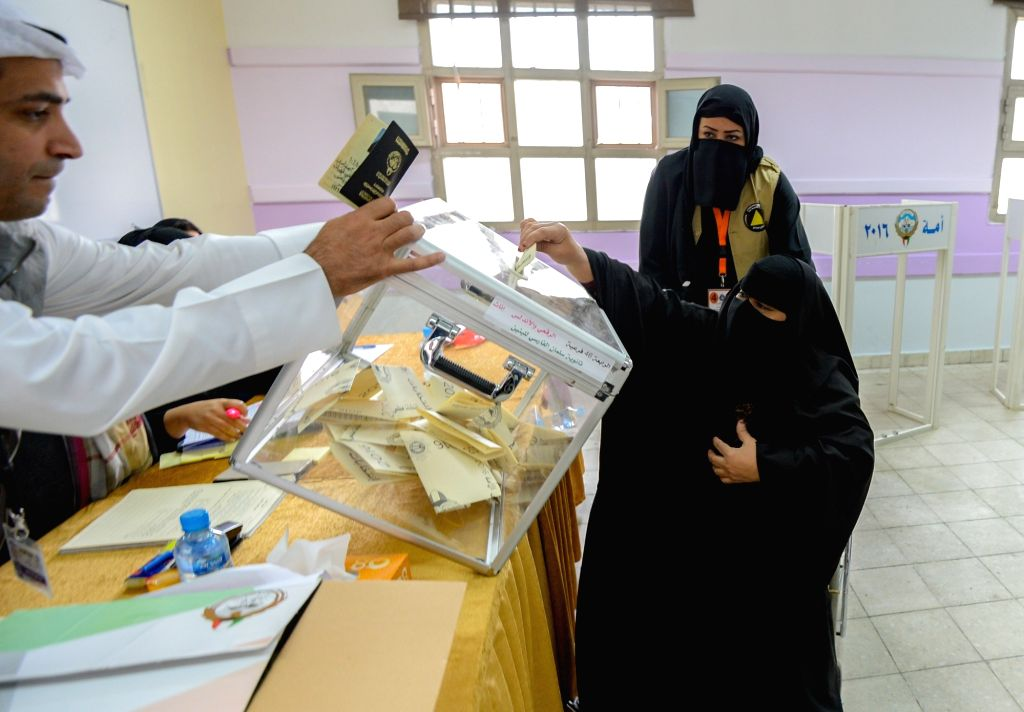 KUWAIT CITY, Nov. 26, 2016 - A Kuwaiti woman casts her ballot for the parliament elections at a polling station in Kuwait City, Kuwait, on Nov. 26, 2016. Kuwaitis on Saturday headed to polling ...