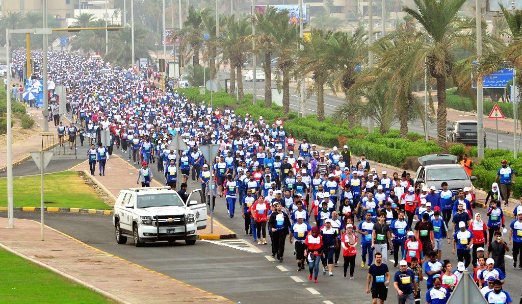 KUWAIT, Dec. 7, 2019 - People participate in a walkathon in Kuwait City, Kuwait, on Dec. 7, 2019.