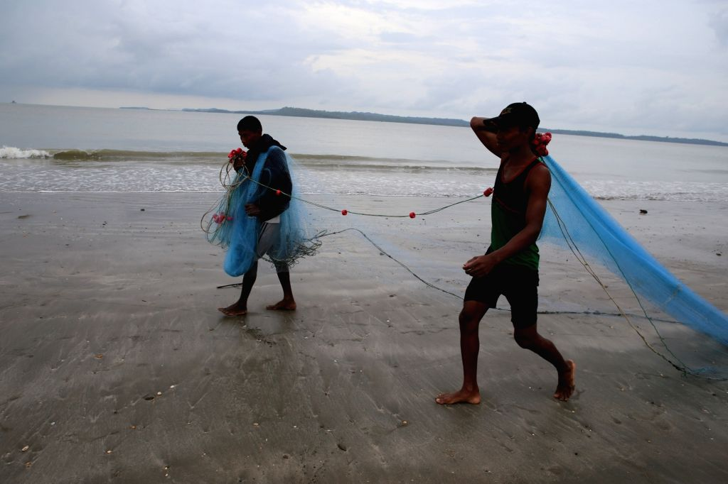 KYAUKPHYU, June 5, 2016 - Fishermen carry the fishing net at the Kyaukphyu beach in Rakhine State, western Myanmar, June 5, 2016. A total of 129 out of 249 Myanmar fishermen, who had served their ...