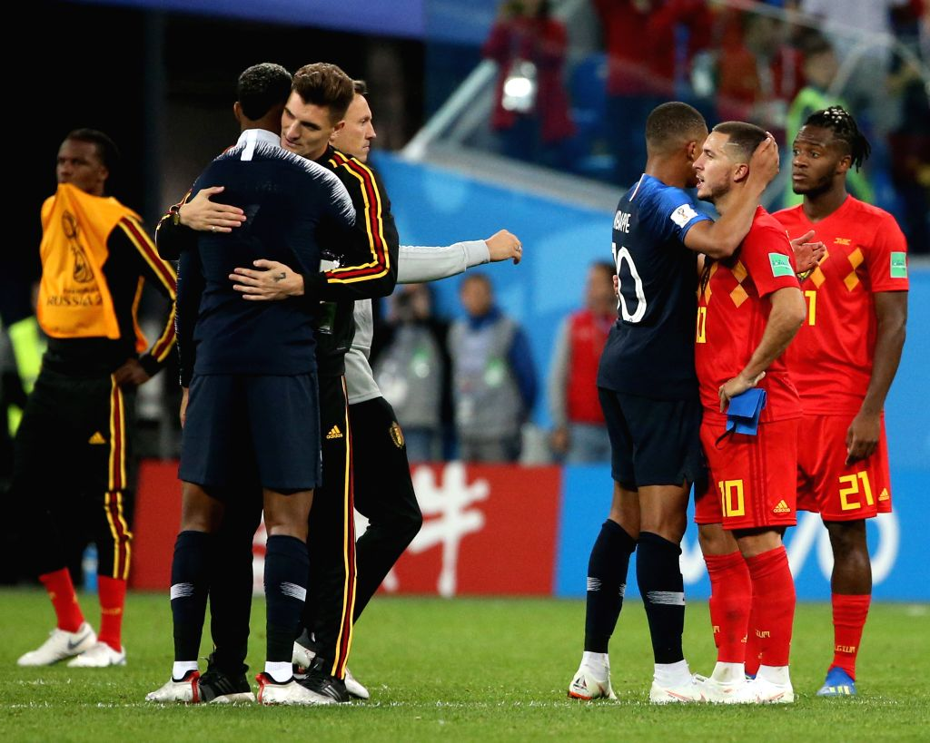 Kylian Mbappe (3rd R) of France tries to comfort Eden Hazard (2nd R) of Belgium after the 2018 FIFA World Cup semi-final match between France and Belgium ...