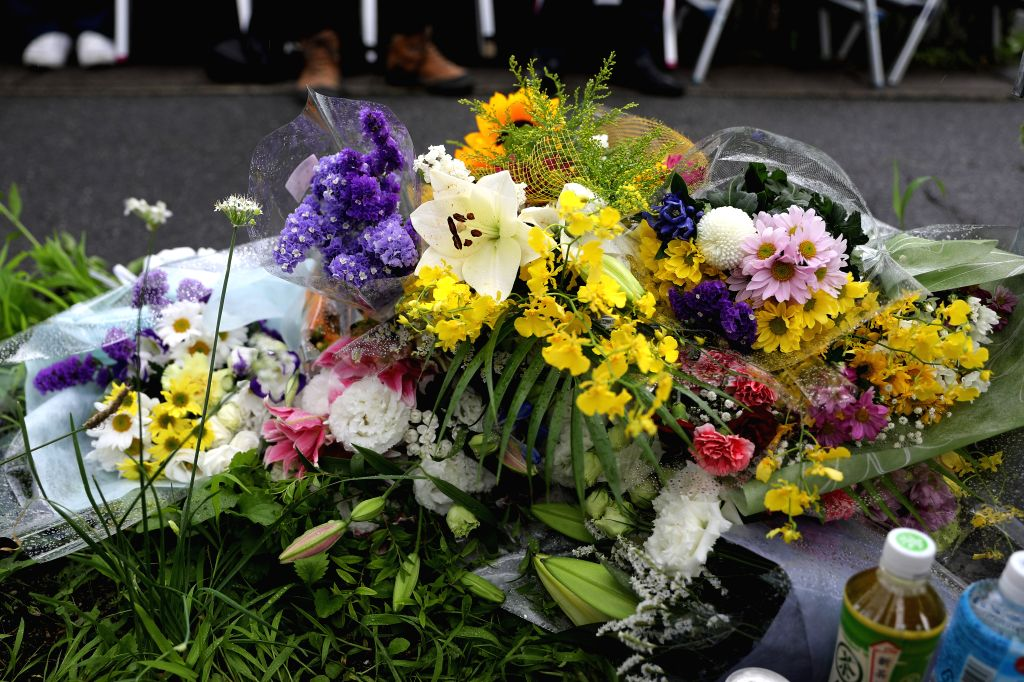 KYOTO, July 19, 2019 - Flowers are seen near the site of an arson attack in Kyoto, Japan, July 19, 2019. Industry insiders from Japan's animation scene along with countless numbers of fans expressed ...