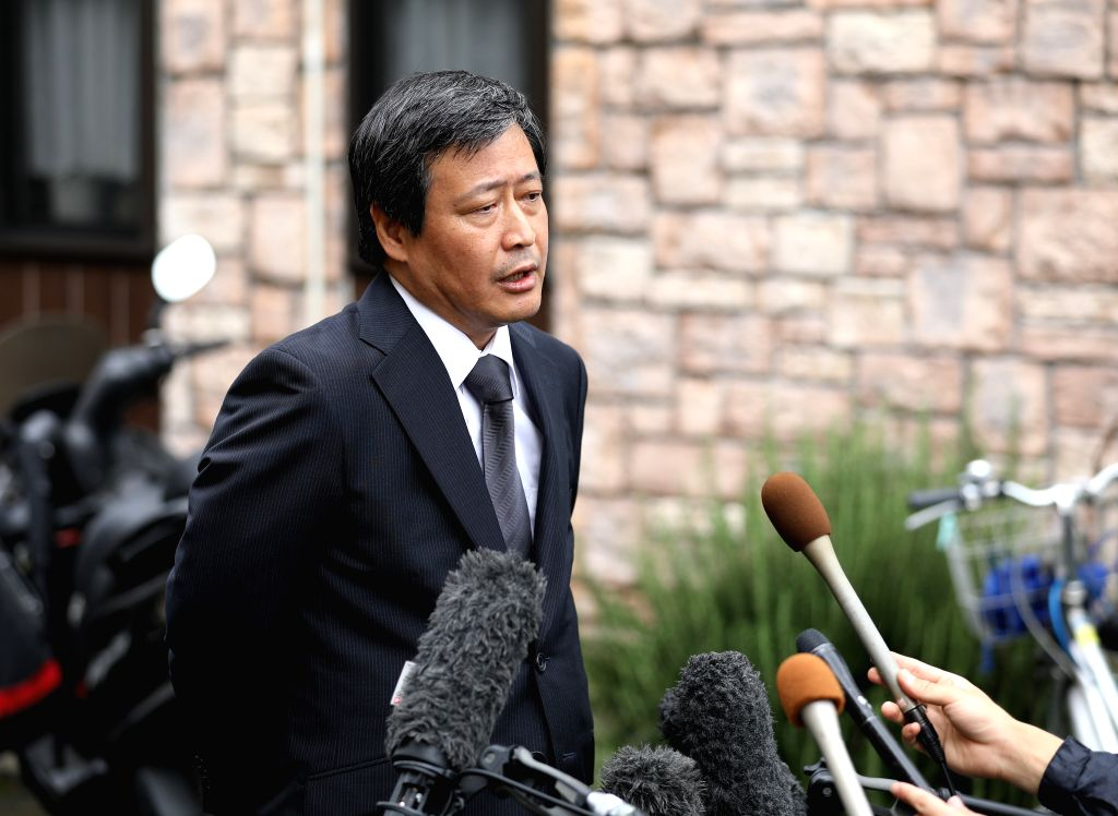 KYOTO, July 19, 2019 - Kyoto prefectural police chief Hideto Ueda takes an interview near a Kyoto Animation studio building which has just suffered from an arson attack in Kyoto, Japan, July 19, ...