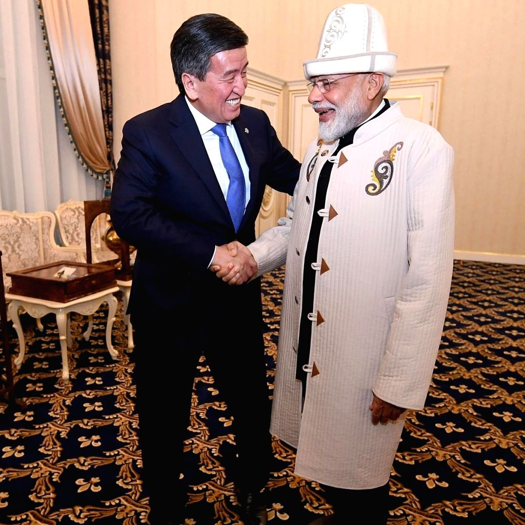 Kyrgyzstan President Sooronbay Jeenbekov presents a Kalpak, the traditional Kyrgyz hat, a Chapan a traditional coat from Kyrgyzstan and a Samovar a container to heat or boil water to Prime ... - Narendra Modi