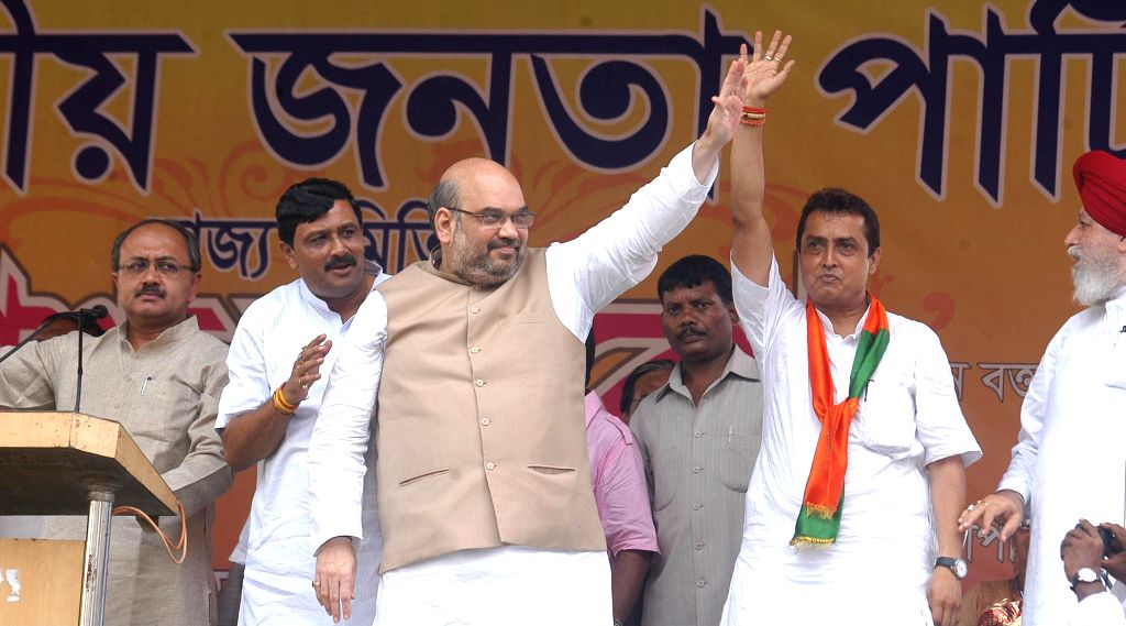 (L-R) BJP leader Siddhartha Nath Singh, West Bengal BJP president Rahul Sinha, BJP chief Amit Shah and Ritesh Tiwari, BJP candidate from Chowringhee assembly seat during a rally in Kolkata on Sept 7, - Nath Singh and Rahul Sinha