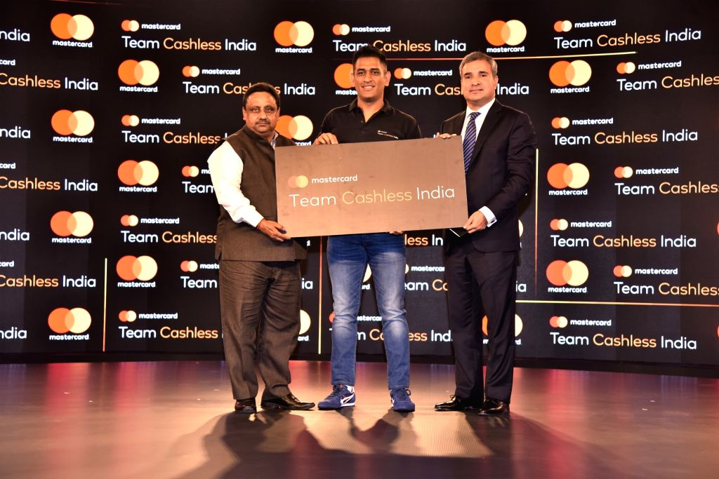 (L-R) Confederation of All India Traders National Secretary General Praveen Khandelwal, Indian cricketer and Mastercard Brand Ambassador M.S. Dhoni and Mastercard Co-President (Asia Pacific) Ari Sarker at the launch of the 'Team Cashless India' initi