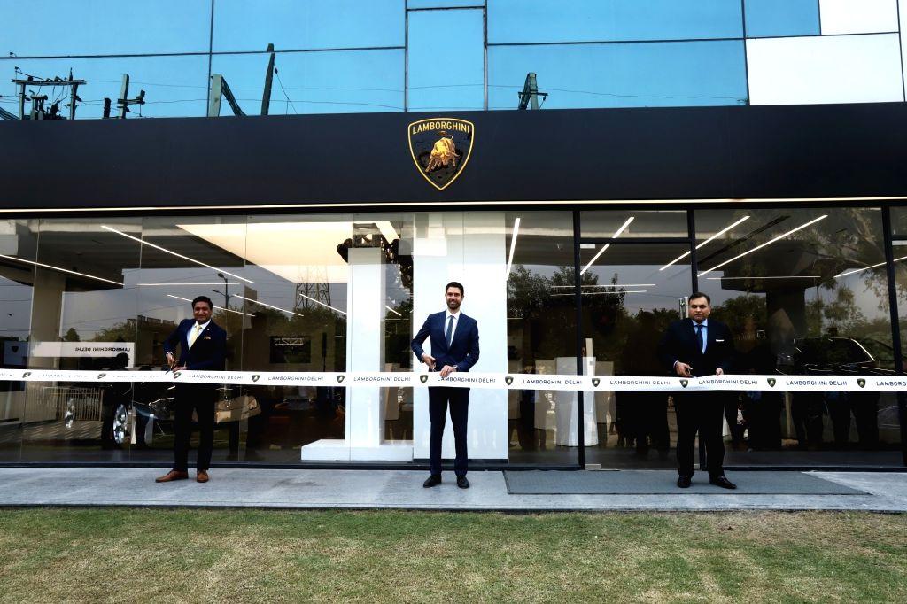 (L-R) Lamborghini India Head Sharad Agarwal, Lamborghini CEO (Asia Pacific) Matteo Ortenzi and Delhi principal dealer Yadur Kapoor at the opening of Lamborghini India???s new showroom in ... - Yadur Kapoor
