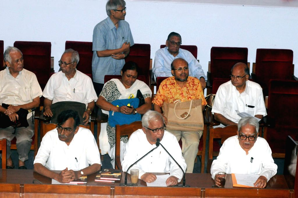(L-R) Leader of Opposition in West Bengal Legislative Assembly Surya Kanta Mishra, former West Bengal Chief Minister Buddhadeb Bhattacharjee, Left Front Chairman Biman Bose and others during 126th ... - Buddhadeb Bhattacharjee and Biman Bose