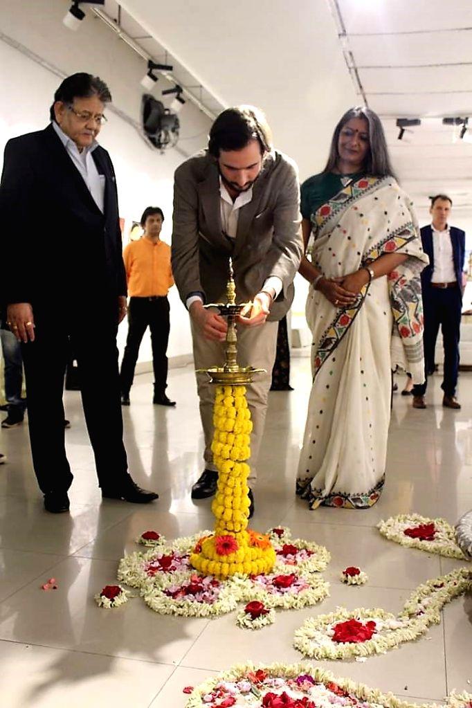 (L-R) Sumit Mazumder, Santiago Ruy, Nandita Palchoudhury - lighting the inaugural lamp.