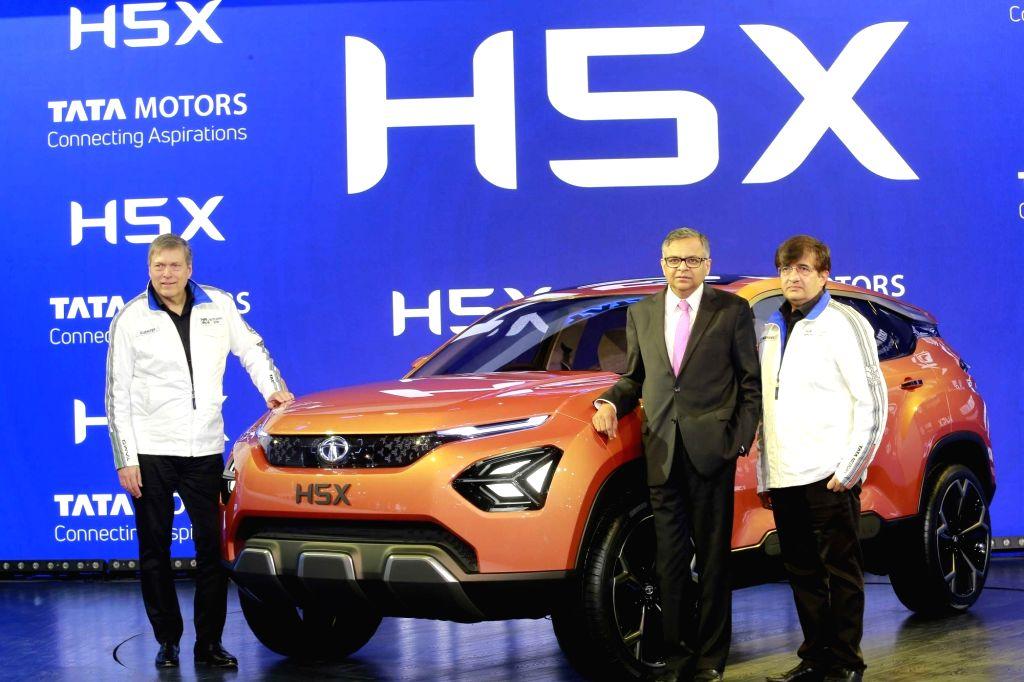 (L-R-) Tata Motors CEO and MD Guenter Butschek, Tata Sons and Tata Motors Chairman N. Chandrasekaran, Tata Motors Passenger Vehicle Business Unit President Mayank Pareek unveil Tata H5X at ...
