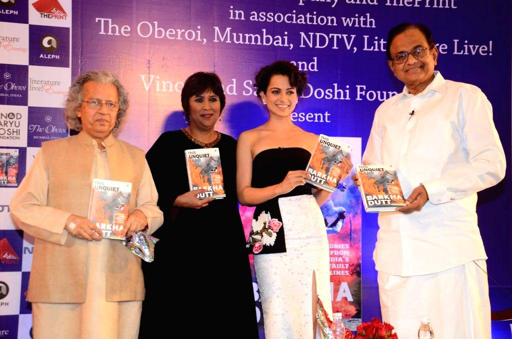 (L-R) Writer Anil Dharker, journalist Barkha Dutt, actor Kangana Ranaut and former FM P Chidambaram during the launch of Barkha Dutt`s book, This Unquiet Land, on Jan 14, 2016. - Kangana Ranaut
