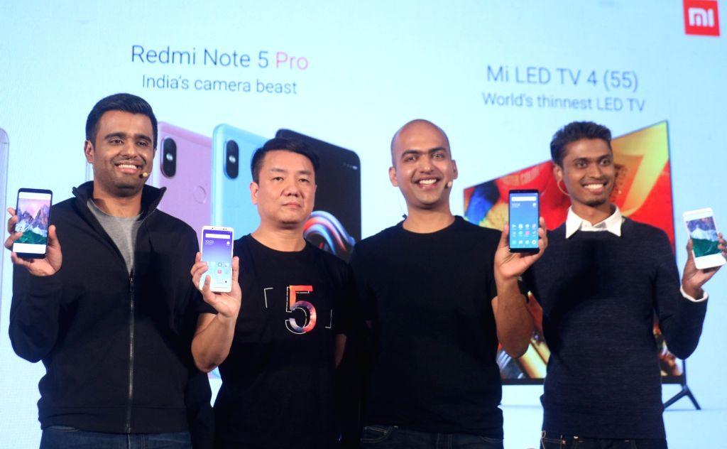 (L-R) Xiaomi India  product Manager Jai Mani, Xiaomi Global Mi TV Head Wang Chuan, Xiaomi India MD Manu Jain and Xiaomi India Product Manager Sudeep Sahu during the launch of Xiaomi ... - Manu Jain