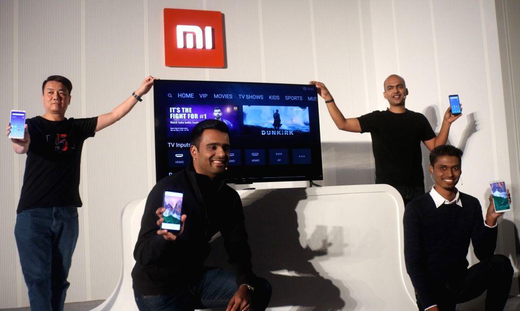 (L-R) Xiaomi India  product Manager, Xiaomi Global Mi TV Wang Chuan, Xiaomi India MD Manu Jain and Xiaomi India Product Operation Manager Sudeep Sahu during the launch of Xiaomi Redmi ... - Manu Jain