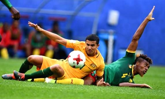 (L to R): Australia's Tim Cahill and Cameroon's Adolphe Teikeu during the 2017 FIFA Confederations Cup match between Cameroon and Australia in Moscow on June 23, 2017.