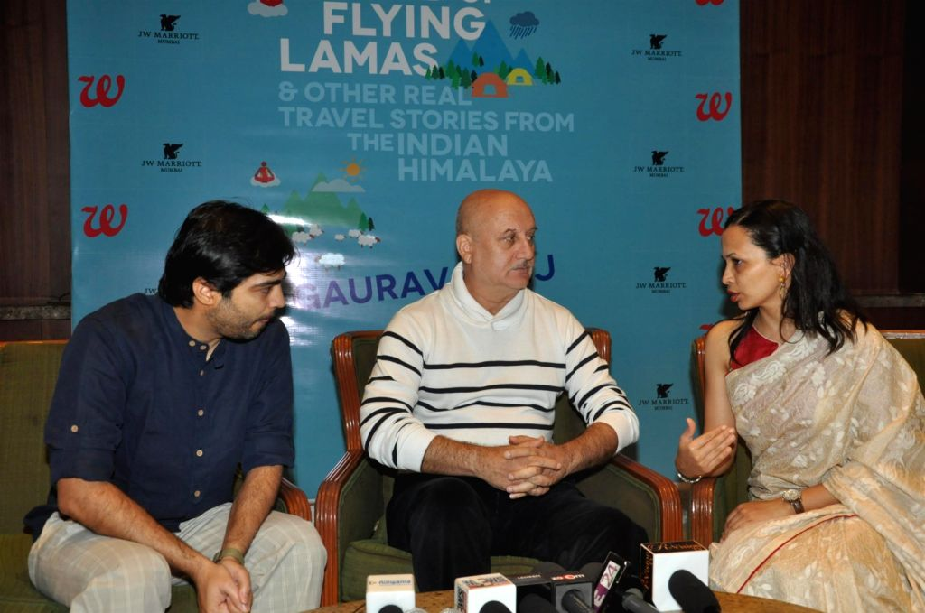 (L to R) Author Gaurav Punj, actor Anupam Kher and Nutritionist Rujuta Diwekar during the release of book 'The Land Of The Flying Lamas' written by Gaurav Punj at JW Marriott in Mumbai on .. - Anupam Kher