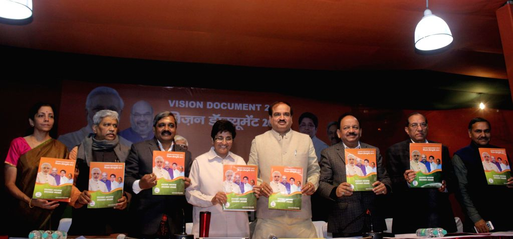 (L to R) BJP leaders Nirmala Sitharaman, Prabhat Jha, Satish Upadhyay, Kiran Bedi, Ananth Kumar, Dr. Harsh Vardhan, Vijay Kumar Malhotra and others during launch of Vision Document at BJP headquarter - Satish Upadhyay, Kiran Bedi, Ananth Kumar and Vijay Kumar Malhotra