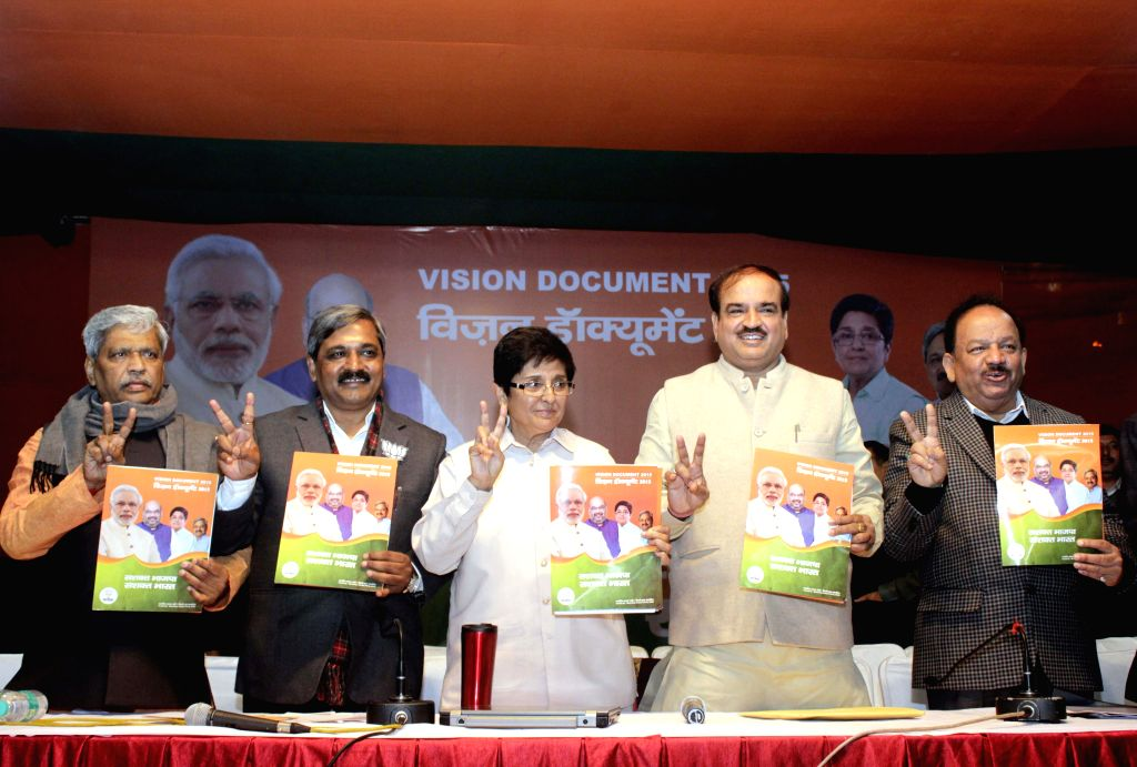 (L to R) BJP leaders Prabhat Jha, Satish Upadhyay, Kiran Bedi, Ananth Kumar, Dr. Harsh Vardhan during launch of Vision Document at BJP headquarter in New Delhi on Feb. 3, 2015. - Satish Upadhyay, Kiran Bedi and Ananth Kumar