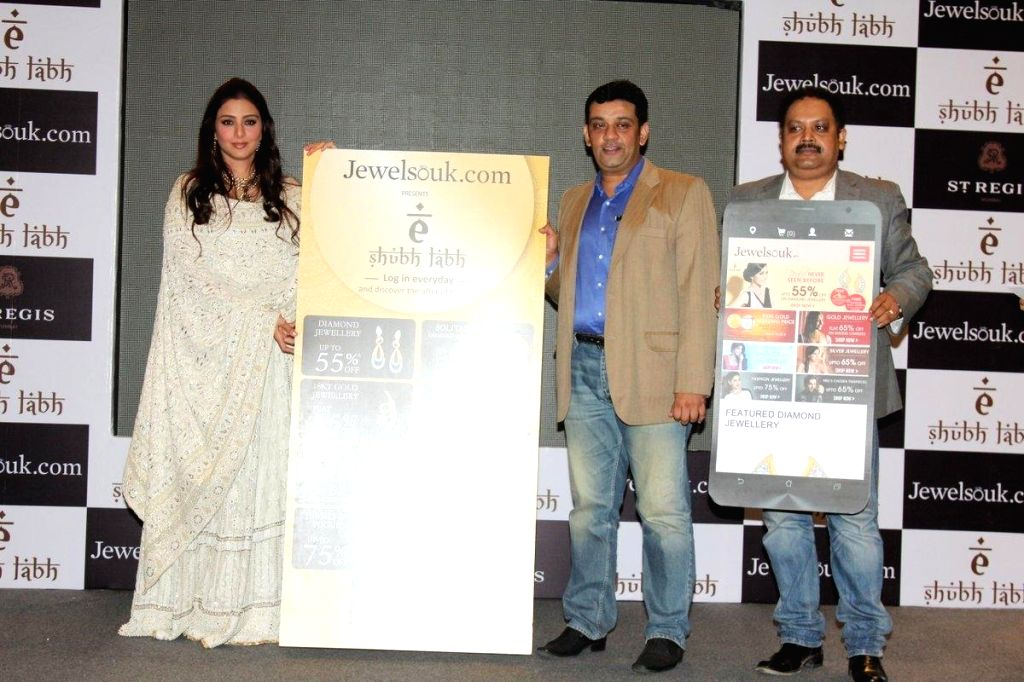 (L to R) Bollywood actor Tabu, Saurav Bhattacharya, President, Jewelsouk.com and Kaushik Mukherjee, CEO, Jewelsouk.com during the launch of mobile app, `E-shub-labh` by Jewelsouk.com in ... - Kaushik Mukherjee