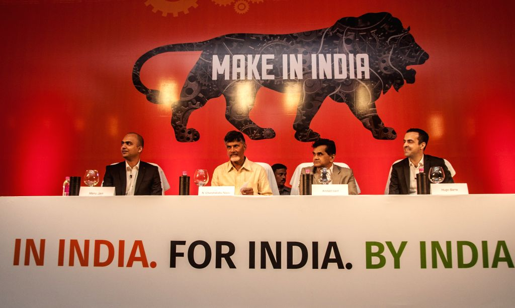 (L to R) CEO Xiaomi India Manu Jain, Andhra Pradesh Chief Minister N. Chandrababu, Secretary department of industrial policy Amitabh Kant and VP Global Xiaomi Hugo Barra during the ... - N. Chandrababu and Manu Jain