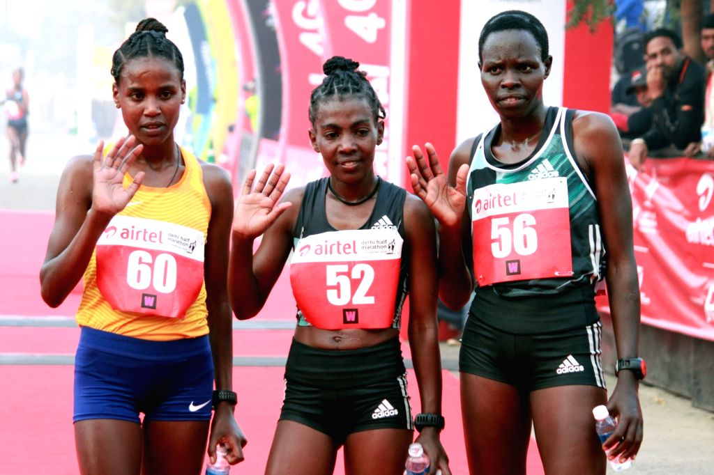(L to R) Ethiopia's Ababel Yeshaneh (2nd place), Ethiopia's Worknesh Degefa (1st place) and Kenyan Helah Kiprop (3rd place) winners of the women's race in Airtel Delhi Half Marathon 2016 ...