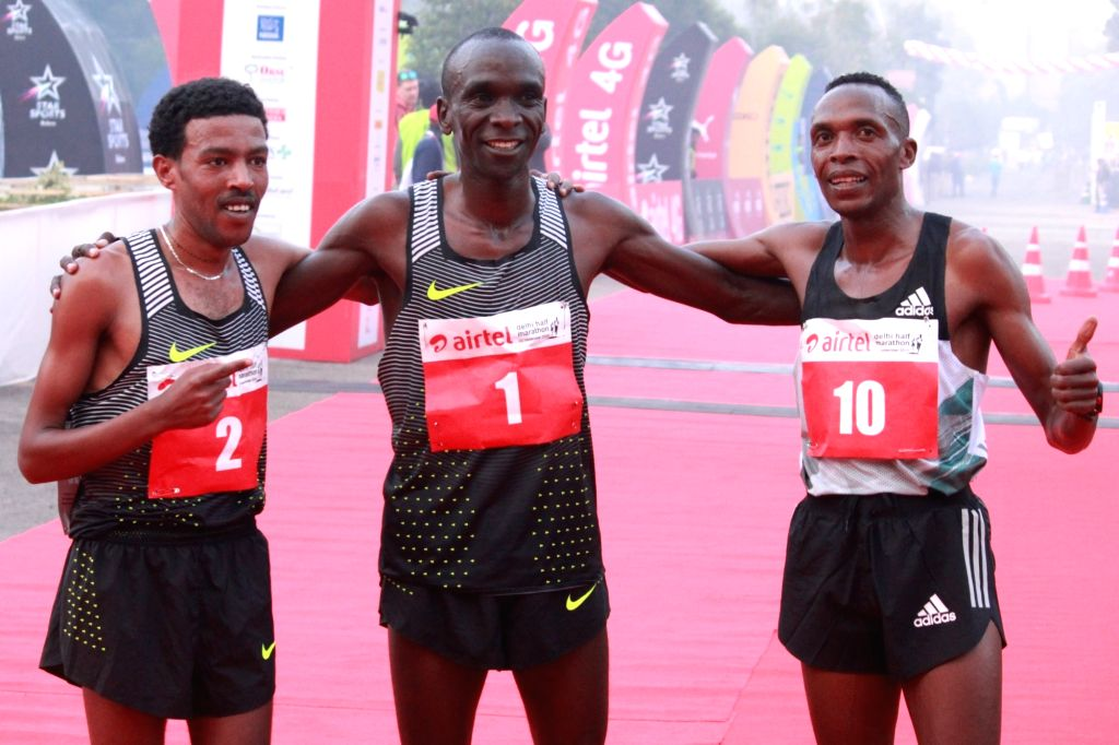 (L to R) Ethiopia's Yigrem Demelash (2nd place), Kenyan Eliud Kipchoge (1st place) and Kenyan Augustine Choge (3rd place) winners of the men's race in Airtel Delhi Half Marathon 2016 at ...