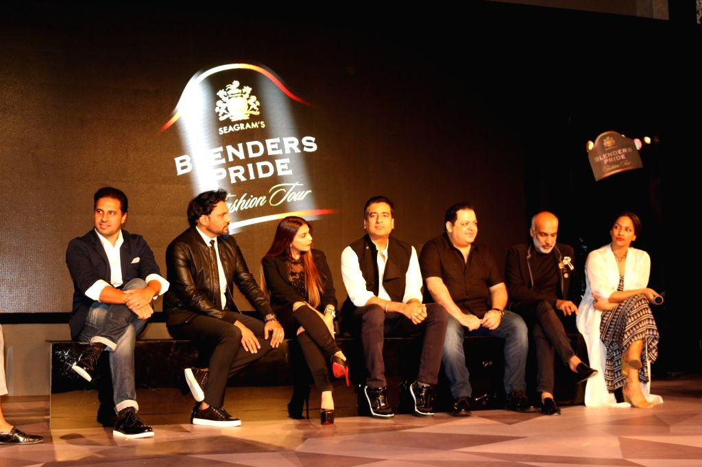 (L to R) Fashion designers Shantanu, Shane Peacock, Falguni, Rahul Khanna, Rohit Gandhi, Manish Arora and Masaba Gupta during the unveiling of Reflections of Style at the preview of Blenders ... - Rahul Khanna, Rohit Gandhi, Manish Arora and Masaba Gupta