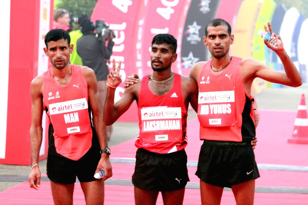 (L to R) Indian athletes Man Singh (3rd place), G Lakshmanan (1st place) and Md. Yunus (2nd place) winner of the Indian men's race in Airtel Delhi Half Marathon 2016 at Jawaharlal Nehru ... - Singh