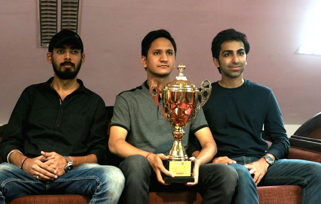 (L to R) Indian cueists Malkeet Singh, Laxman Rawat and Pankaj Advani with the Asian Team Snooker Championship Trophy during a felicitation programme in New Delhi on July 7, 2017. - Malkeet Singh and Pankaj Advani