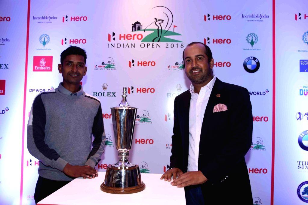 (L to R) Indian golfers Rashid Khan and Shiv Kapur unveil the Indian Open 2018 trophy in New Delhi on Feb 13, 2018. - Rashid Khan