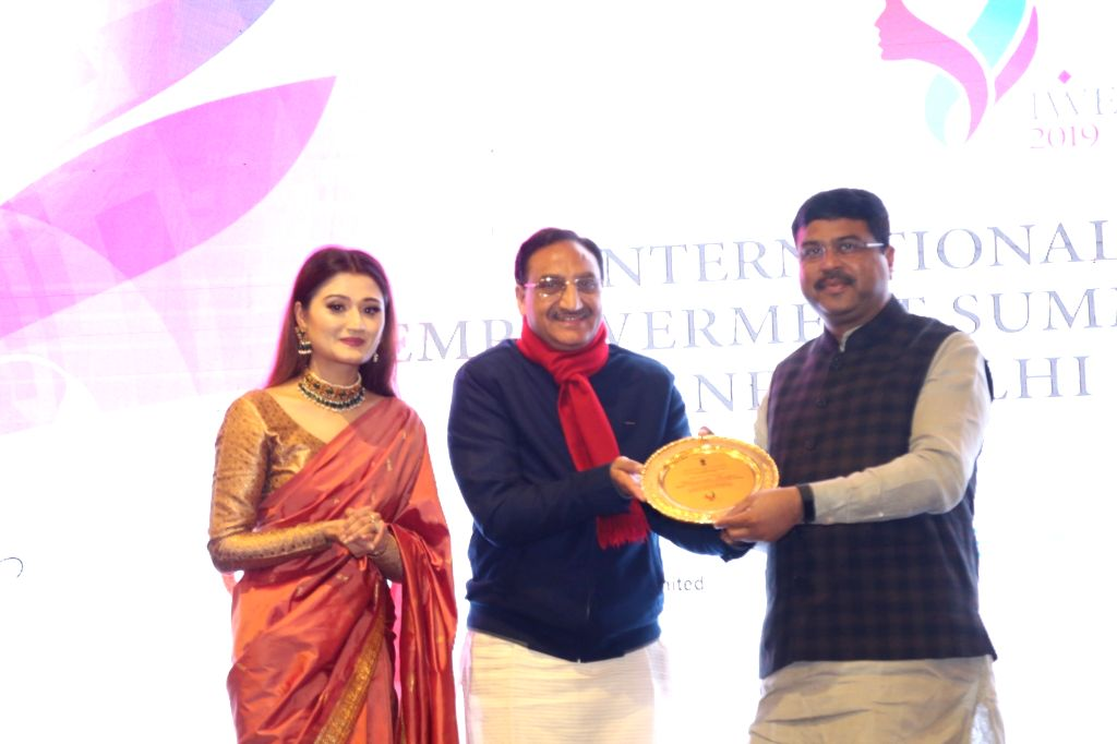 (L to R) IWES Chairperson and Kathak danseuse Arushi Nishank, BJP leader Ramesh Pokhriyal and Union Petroleum Minister Dharmendra Pradhan at the International Women Empowerment Summit and ... - Dharmendra Pradhan