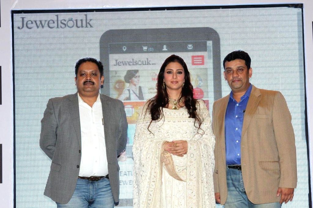 (L to R) Kaushik Mukherjee, CEO, Jewelsouk.com, Bollywood actor Tabu and Saurav Bhattacharya, President, Jewelsouk.com during the launch of mobile app, `E-shub-labh` by Jewelsouk.com in ... - Kaushik Mukherjee