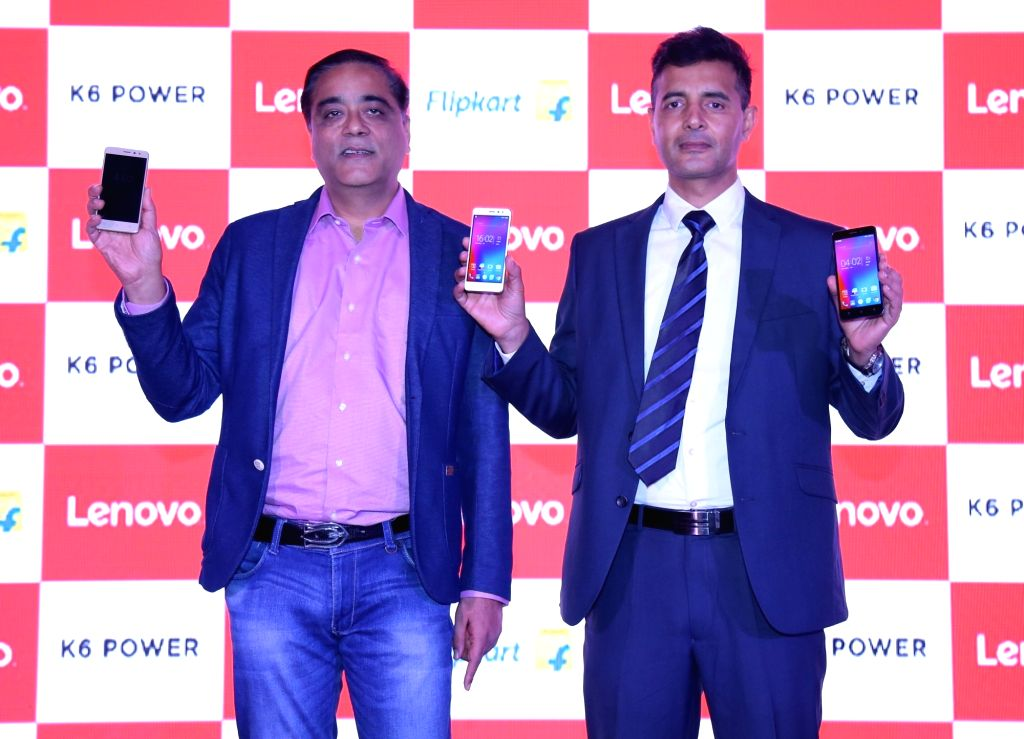 (L to R) Lenovo Mobile Business Group India Executive Director Sudhin Mathur and Flipkart Vice President Mobiles Ajay Yadav during the launch of Lenovo K6 Power in New Delhi on Nov 29, ... - Ajay Yadav