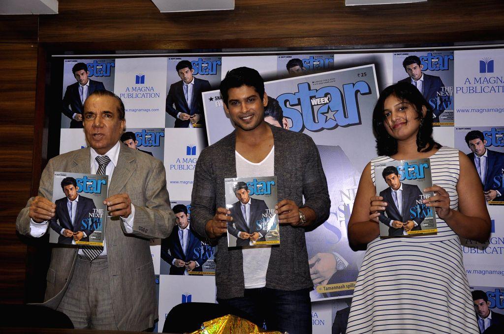 (L to R) Nari Hira, CMD, Magna Publishing Company, Bollywood actor Sidharth Shukla and Srividya Menon, Editor Star Week Magazine during the unveiling of latest cover of Star Week magazine in Mumbai .. - Sidharth Shukla and Srividya Menon