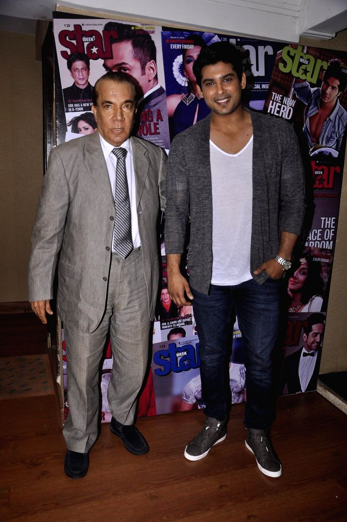 (L to R) Nari Hira, CMD, Magna Publishing Company and actor Sidharth Shukla during the unveiling of latest cover of Star Week magazine in Mumbai on July 31, 2014. - Sidharth Shukla
