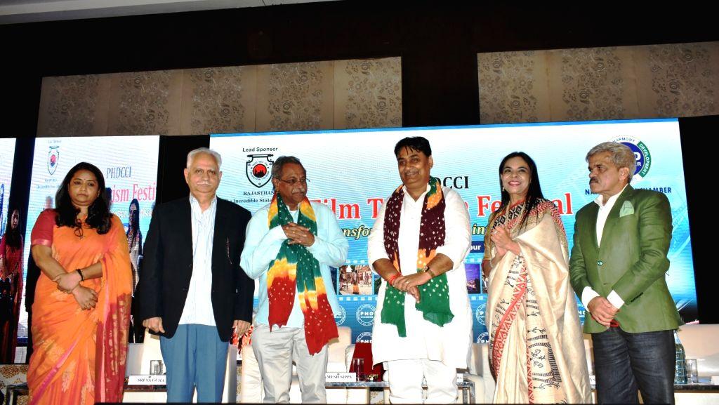 (L to R) Principal Secretary Tourism Sreya Guha, directors Ramesh Sippy, Shaji N. Karun, MoS Tourism Govind Singh Dotasra; Rajasthan PHDCCI Chairperson Jayshree Periwal and PHDCCI Tourism ... - Govind Singh Dotasra