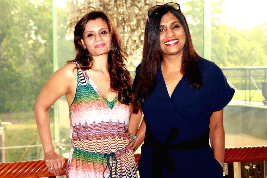 "(L to R) Producer Priti Gupta and director Anuradha Menon during a press meet to promote their film ""Waiting"" in New Delhi, on May 27, 2016. - Anuradha Menon and Priti Gupta"