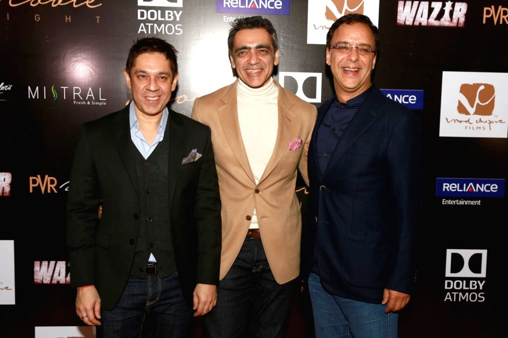 (L to R) PVR Pictures Joint Managing Director Sanjeev Kumar Bijli, Chairman Ajay Bijli and filmmaker Vidhu Vinod Chopra during a press conference to promote their upcoming film `Wazir`, in ... - Sanjeev Kumar Bijli and Vidhu Vinod Chopra