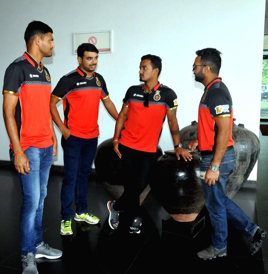 (L to R) Royal Challengers Bangalore (RCB) players Pavan Deshpande, Anirudha Ashok Joshi, Pawan Negi and Parthiv Patel during a press conference in Kolkata on March 29, 2018 - Anirudha Ashok Joshi and Parthiv Patel