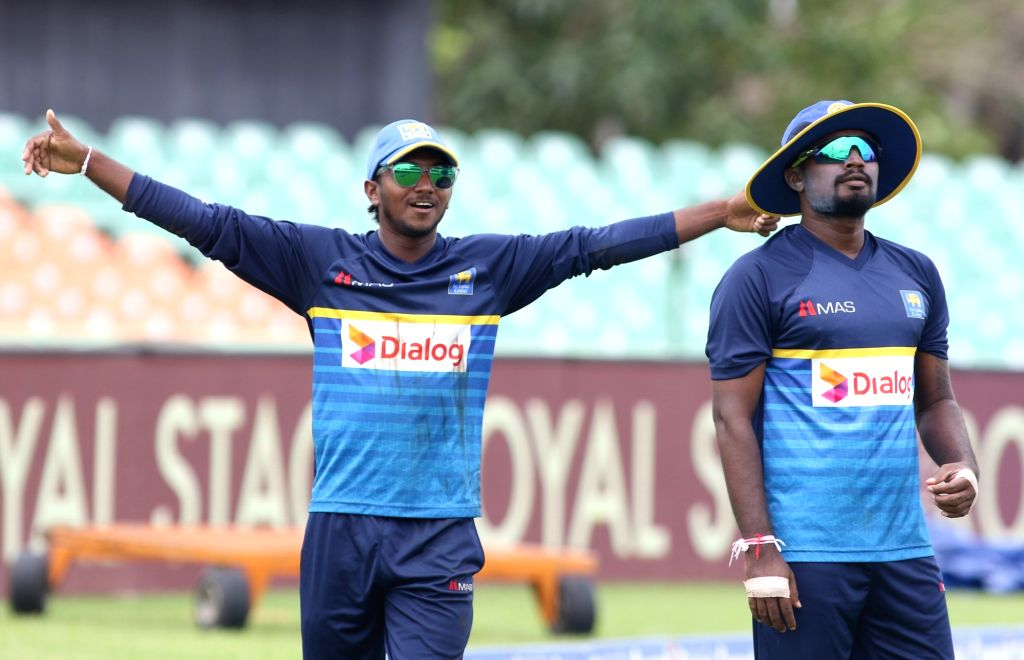 (L to R) Sri Lankan cricketers Akila Dananjaya and Malinda Pushpakumara during a practice session ahead of the first one-day international cricket match against India in Dambulla, Sri Lanka ...