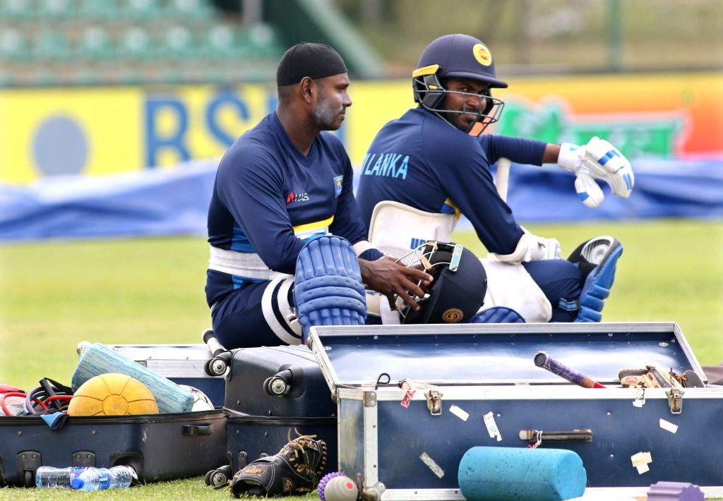 (L to R) Sri Lankan cricketers Angelo Mathews and Upul Tharanga during a practice session ahead of the first one-day international cricket match against India in Dambulla, Sri Lanka on Aug ...