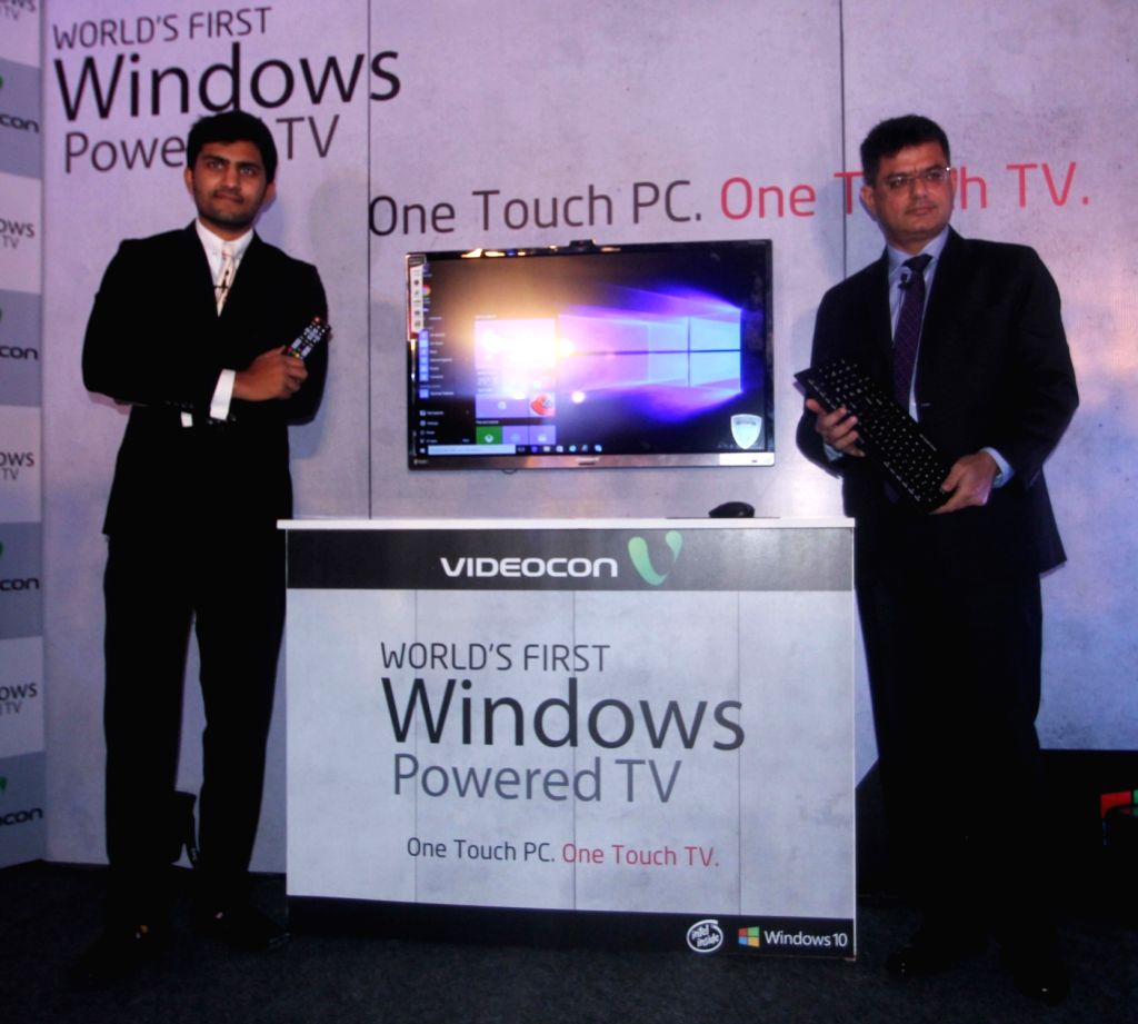 (L to R) Videocon technology head Akshay Dhoot and Microsoft Director (Windows Business Group) Vineet Durani during the launch of Windows 10 powered LED TV in New Delhi on Oct 28, 2015.