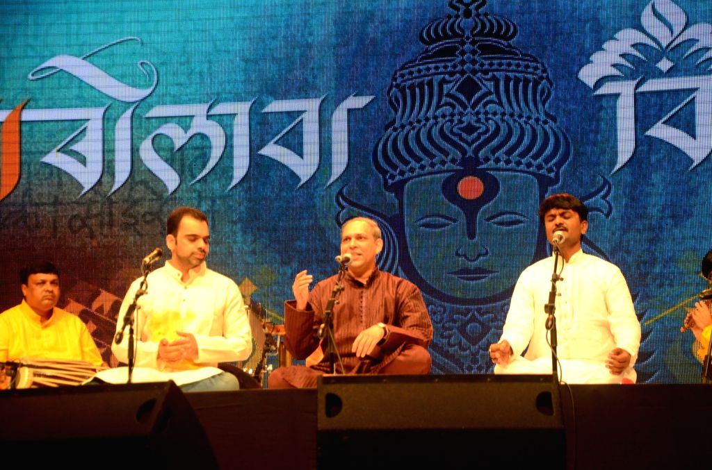"(L to R) Vocalist Rahul Deshpande, Anand Bhate and Jayateerth Mevundi perform during ""Bolava Vitthal"" dedicated to late classical vocalist Ganasaraswati Kishori Amonkar in Mumbai on ... - Rahul Deshpande"