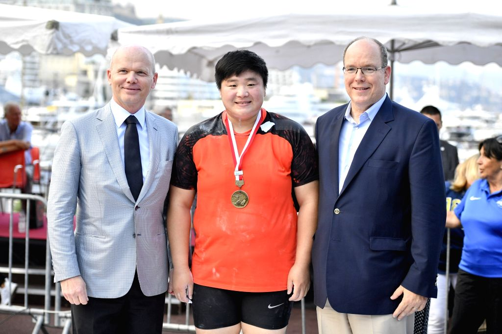 LA CONDAMINE, July 20, 2018 - Prince of Monaco Albert II (R) poses for photos with Chinese athlete Gong Lijiao (C) after the women's shot put final of the IAAF Diamond League competitions in La ...