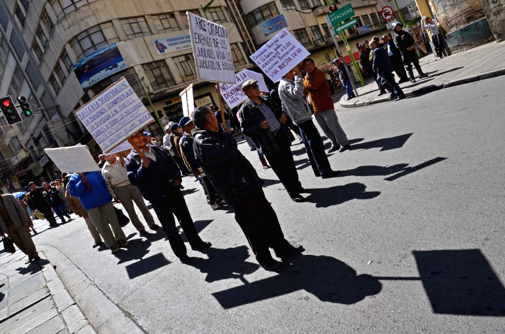 Retired men hold a protest in La Paz, Bolivia, on Aug. 25, 2014.